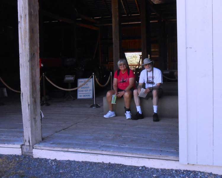 Laura and Harvey take rest break in the cool of Ike's barn